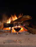 Fireplace and wine Royalty Free Stock Photography