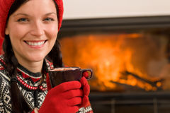 Fireplace winter christmas woman drink home Stock Images