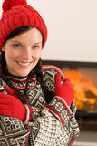 Fireplace winter Xmas young woman wear sweather Royalty Free Stock Photo