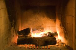 Fireplace with wood. And flame Stock Photos