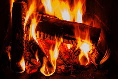 Fireplace with wood brick and fire Royalty Free Stock Photos