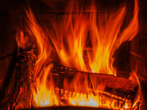 Fireplace with wood brick and fire Stock Image