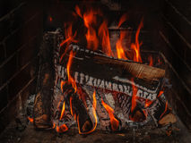 Fireplace with wood brick and fire Royalty Free Stock Photo