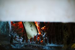 Fireplace with wood burning red embers. Close up view Royalty Free Stock Photo