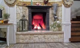 Fireplace with wood fire at Christmas Stock Photos