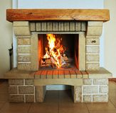 Fireplace. With wood and fire closeup Royalty Free Stock Images