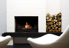 Fireplace, wood and lounge chairs