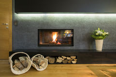 Fireplace with wood stocks Royalty Free Stock Image
