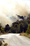 Fires broach road in Athens. Smoke filled sky, on the edge of Athens royalty free stock photography