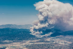 Fires burning in the mountains in north Los Angeles. In the daytime from aircraft Royalty Free Stock Photo