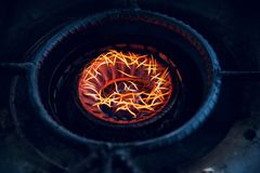 Yellowish fires of a cooking stove. Fires of a traditional cooking stove isolated unique photo stock image