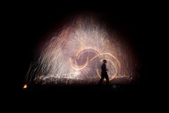 Fireshow. Fire show a lot of sparks in the night Stock Image
