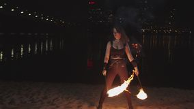Fireshow artist performing work with lit torches stock video footage