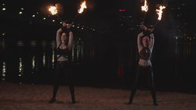 Fireshow artists juggling burning torches outdoor stock video