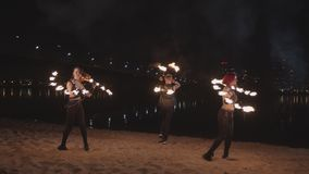 Fireshow artists turning around juggling fire outdoors stock video footage