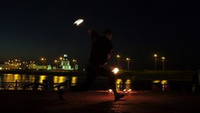 Fireshow performance with burning torch at night outdoor stock footage