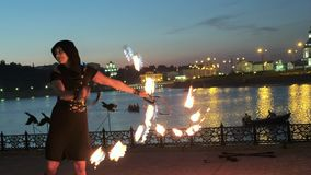 Fireshow performance with burning torch at night outdoor 4k stock video