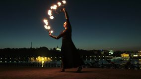 Fireshow performance with burning torch at night outdoor 4k stock footage