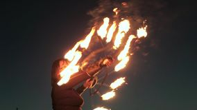 Fireshow performance with burning torch at night outdoor 4k stock video footage