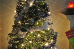 Fireside Christmas Tree. Green fully decorated christmas tree with roaring fire Stock Photography