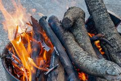 Flames and Smoke of a Fire Burn Woodpile royalty free stock images