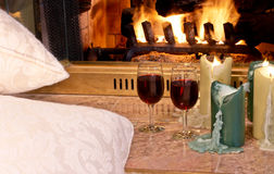 Fireside wine & candles Royalty Free Stock Photo