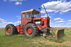 Versatile tractor with a blade. FIRESTEEL, SOUTH DAKOTA, June 23, 2017: The old versatile tractor is a Canadian brand of agricultural equipment that has also Stock Images