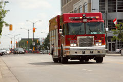 Firetruck. Speeding down a street to a call Royalty Free Stock Photos