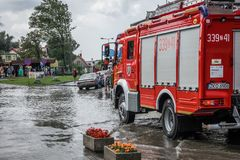 Firetruck arriving to drain flooded area Stock Images