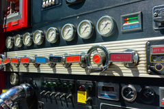 Firetruck control gears, levers and dials. Firetruck with with working knobs and levers, clocks and dials Stock Image
