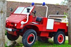 Firetruck del vintage para la patrulla de maderas Imágenes de archivo libres de regalías