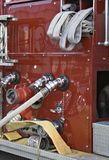 Firetruck Details. Details of a shiny red firetruck - hoses and gages on side of truck stock photography