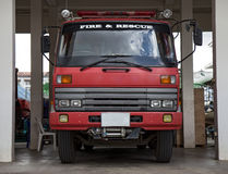 Firetruck in firehouse. Front view at firetruck in firehouse Stock Photos