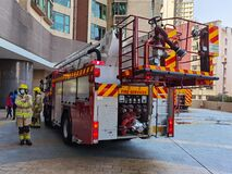 6 2 2021 firetruck and firemen on duty in a residential complex in hong kong