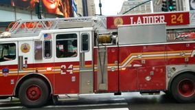 Firetruck at full speed in midtown Manhattan stock footage