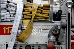 Firetruck and hose. Yellow and white hose folded up in the back of a fire truck Royalty Free Stock Image