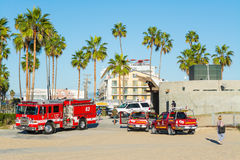 Firetruck and lifeguard trucks in Venice beach Stock Images