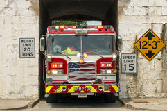 Firetruck in a Tunnel. A firetruck drives through a narrow tunnel at Fort Monroe Stock Image