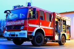 Firetruck utanför stationen Royaltyfria Bilder