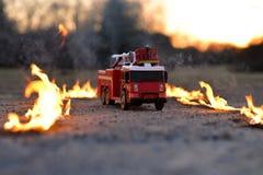 Firetrucks. Toy Firetruck to the scene Stock Photography