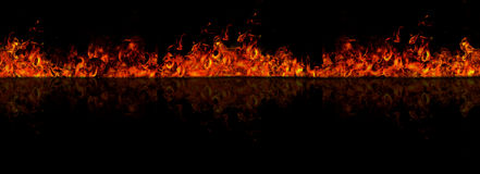 Firewall. Isolated fire on black backgroun with reflection on floor Stock Photography
