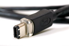 Firewire cable isolated. Isolated firewire cable detail before white background Royalty Free Stock Photography
