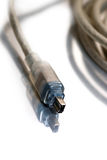 Firewire cord for digital video. The standard in digital video Royalty Free Stock Photography
