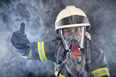 Firewoman in fire protection suit. And mask Stock Photos