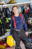 Firewoman Holding Helmet At Fire Station Royalty Free Stock Image