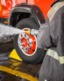 Firewoman Practicing At Fire Station Royalty Free Stock Photos