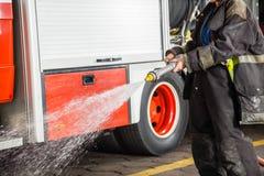 Firewoman Spraying Water During Training Royalty Free Stock Image
