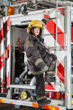 Firewoman Standing On Truck At Fire Station Royalty Free Stock Images