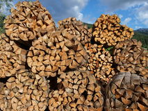 Firewood. Lots pile of woods in  village  under the blue sky Stock Images
