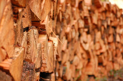 Firewood. Split firewood stacked up in a big neat pile Royalty Free Stock Images